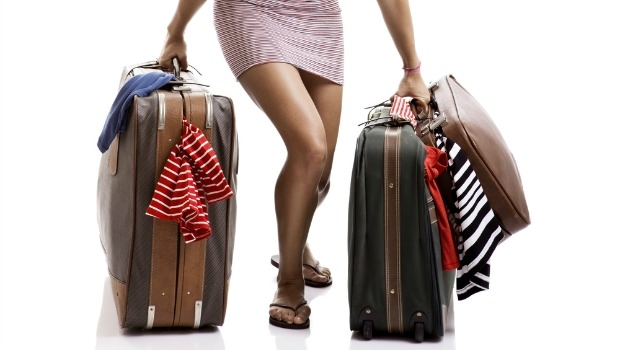 Woman with overloaded baggage