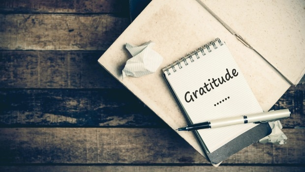 'Gratitude' written on a notepad