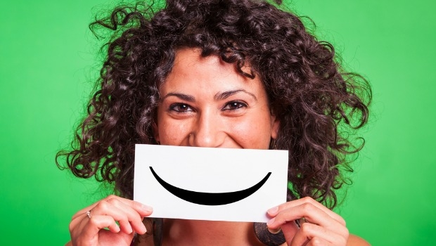 Woman with paper smile