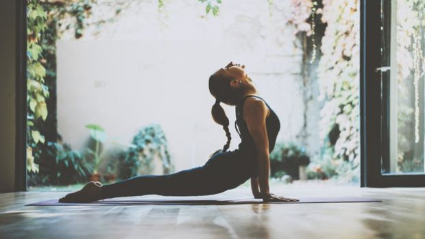 Woman doing yoga in her home.