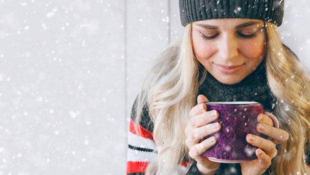 Woman with steaming cup of cocoa