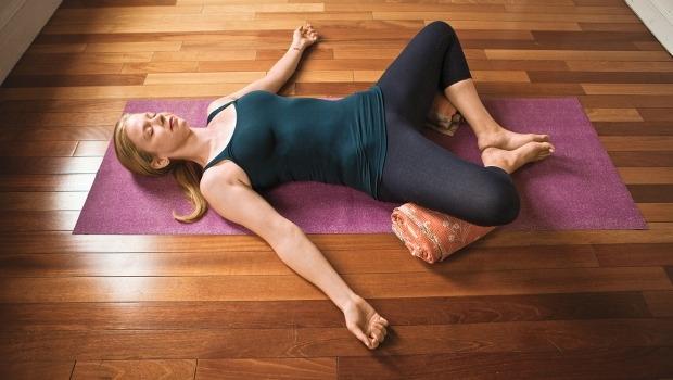 Woman doing restorative yoga