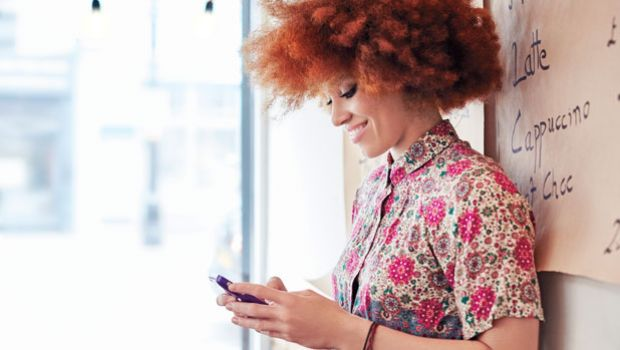 Woman tweeting on her phone