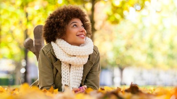 Woman in fallen leaves