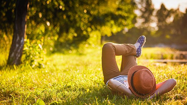 Girl relaxing on grass in the shade
