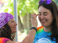 Woman getting her face painted.