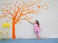 Girl reaching for tree
