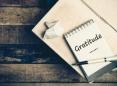 'Gratitude' written on a notepad