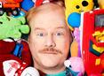 Jim Gaffigan buried in toys