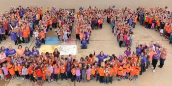 "Castle Hills Elementary school kids spelling out ""happy"""
