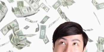Guy with money floating around