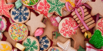 Colorful mix of Christmas-themed decorated cookies