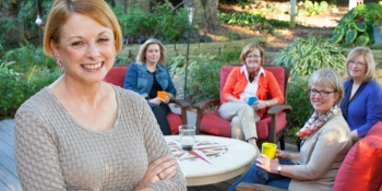 Karol Nickell with friends in her backyard