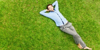 Guy relaxing on the grass
