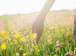 Woman in a field of wildflowers