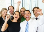 Happy workers cheering in an office