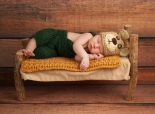 Baby sleeping on a tiny bed