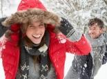 Couple having a fun snowball fight.