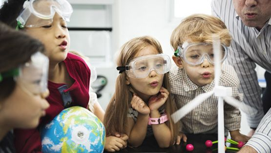 Kids in goggles for science experiment