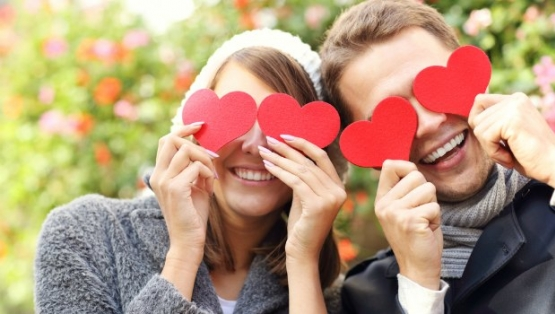 Cute couple with hearts over their eyes.