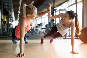 women working out in gym together