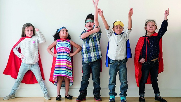 Diverse array of colorfully dressed, happy kids.