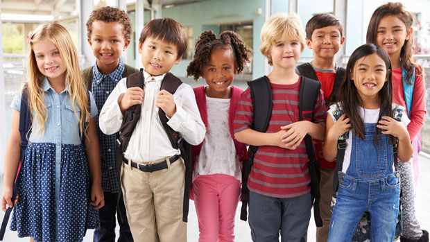 Group of happy elementary school kids.